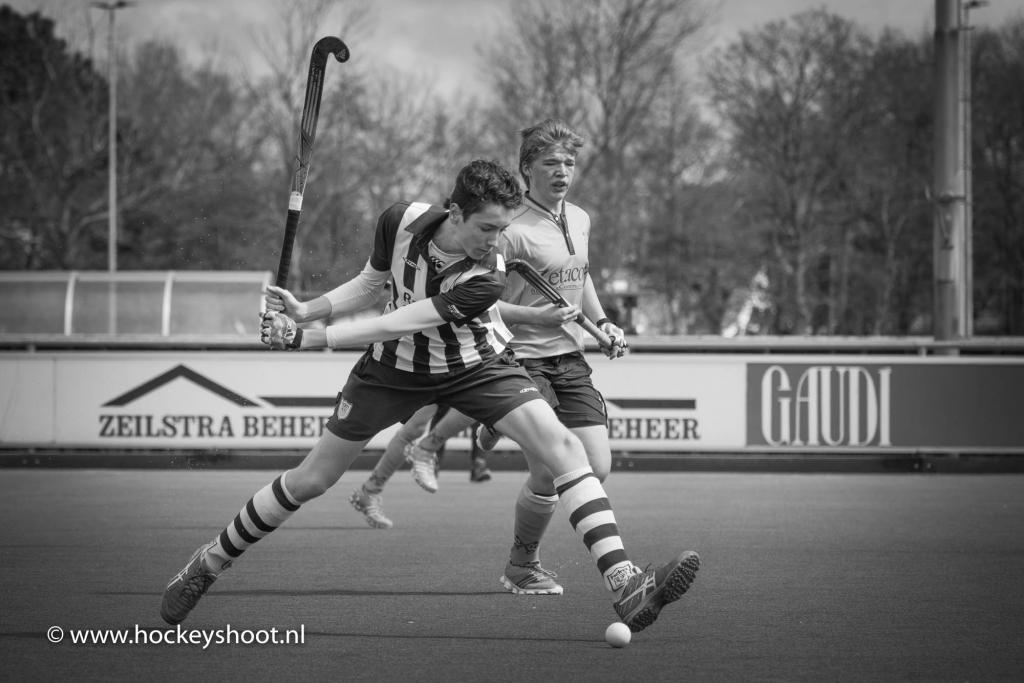 Hockey actie in zwart-wit